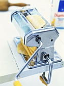Pasta maker with sheet of pasta dough