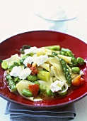 Pasta pieces with green asparagus and goat's cheese