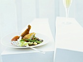 Poussin in potato coating with carrot and ginger puree