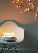 A birthday cake with lots of candles