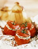 Tomatoes stuffed with ricotta and onions stuffed with bread
