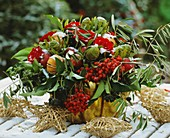 A winter bouquet of roses, ivy, rowan and ornamental apples