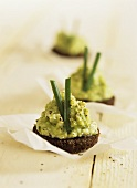 Avocado mousse on pumpernickel bread