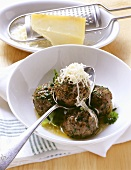Spleen dumplings with herb butter and hard cheese