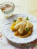 Rupfhauben (sweet, Bavarian pasta dough pastries) with apple sauce (Bavaria, Germany)