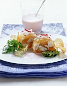 Fried fish in aspic on radish foam
