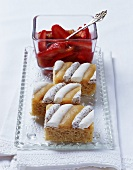 Iced sponge slices with strawberry and rhubarb compoté