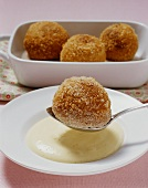 Kartäuserklösse (Franconian French-toast balls) in a white wine foam