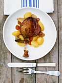Leg of duck with potatoes and curry