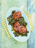 Lentil salad with cooked sausage meat