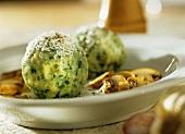 Spinach dumplings with a mushroom ragout