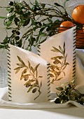 Lanterns decorated with olive branches