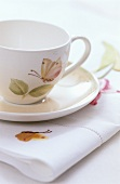 A cup, saucer and a napkin