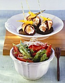 Aubergine rolls with cream cheese and an asparagus and strawberry salad