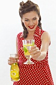 A retro-style girl offering a glass of lemonade