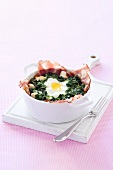 Spinach bake with bacon and fried egg