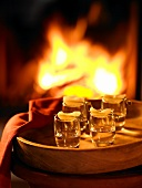 Four glasses of William's Pear schnapps on a tray