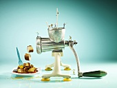 A mincer with miniture figures and curried sausage