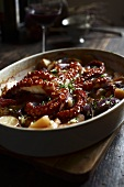 Oven-baked octopus with potatoes and onions