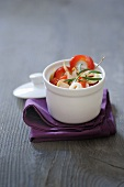 Squid rings with tomato and pepper