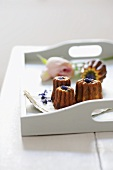 Canneles with violets