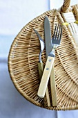 Cutlery on a picnic basket