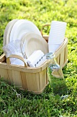 A basket with picnic crockery