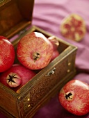 Pomegranates in a wooden crate