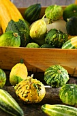 Ornamental pumpkins in a wooden crate
