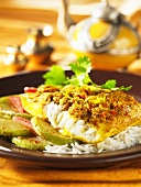 Fish with a mustard crust on a bed of rice (India)