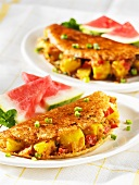 Rice and lentil pancakes with watermelon