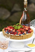 A berry tart on a table outside