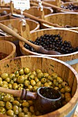 Preserved olives in barrels at a market