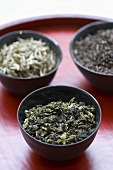 Three different types of tea in bowls