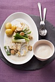 Cod with mushrooms in a cider sauce