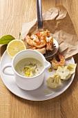 Artichoke sauce and king prawns