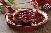 A red fruit tart in a dish