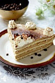 A slice of layered coffee cake
