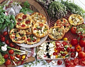 Various mini pizzas plus ingredients