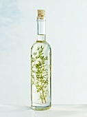 A bottle of sunflower oil with thyme
