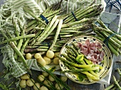 An arrangement of green asparagus, ham and potatoes
