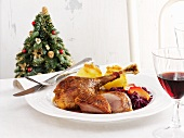 Roast goose with red cabbage and potato dumplings for Christmas dinner
