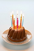 Bundt cake with colourful candles