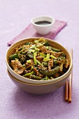 Chicken stir fry with vegetables and sesame
