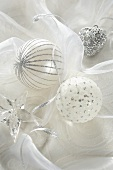 White Christmas baubles, silver hanging heart and a glass star