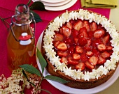 Strawberry cake with elderflower syrup