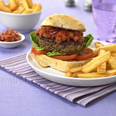 Burger with barbecue sauce and chips