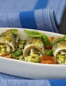 Herring rolls with feta and herb filling