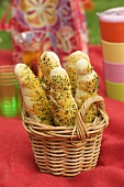 Herb and sesame baguettes in a basket