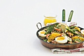 Red quinoa salad with crabmeat, asparagus and egg